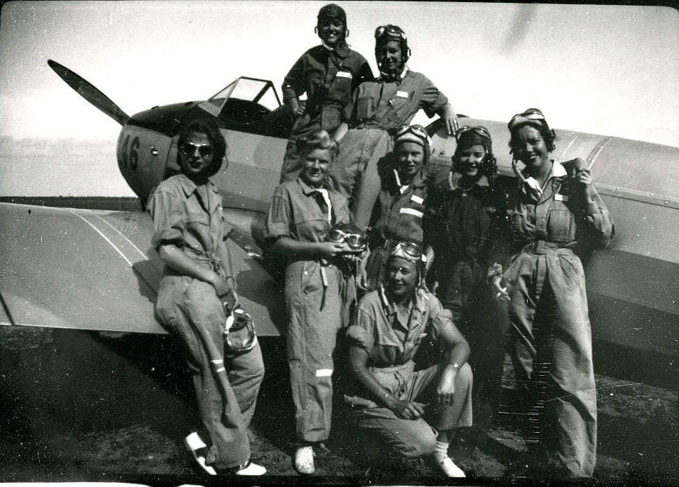 "WASPs with PT-19, the first plane usually flown in primary training. Women on far left in dark glasses is Gertrude ""Tommy"" Tompkins, according to Texas Women's University Libraries WASP Archives."