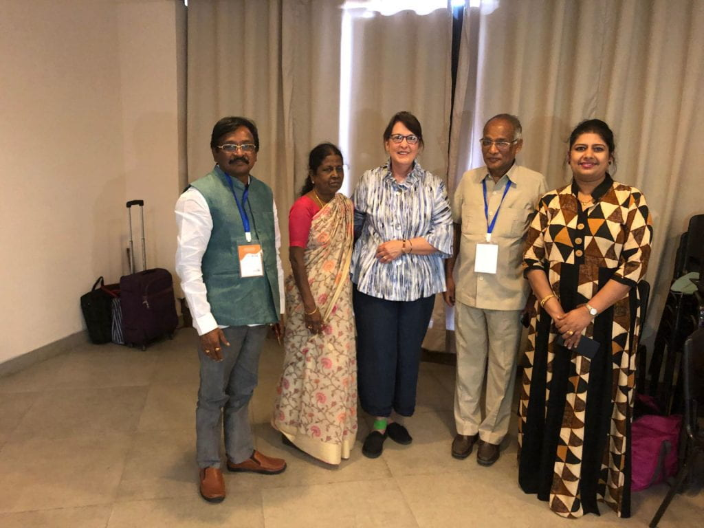 Helen Teague and members of the educational community in Hyderabad